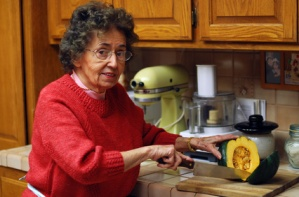 grandmother cuts vegetables