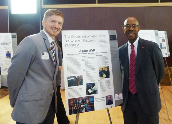 Matthew Fullen and Ohio State University President Michael V. Drake at a ceremony recognizing the Schweitzer Fellowship.
