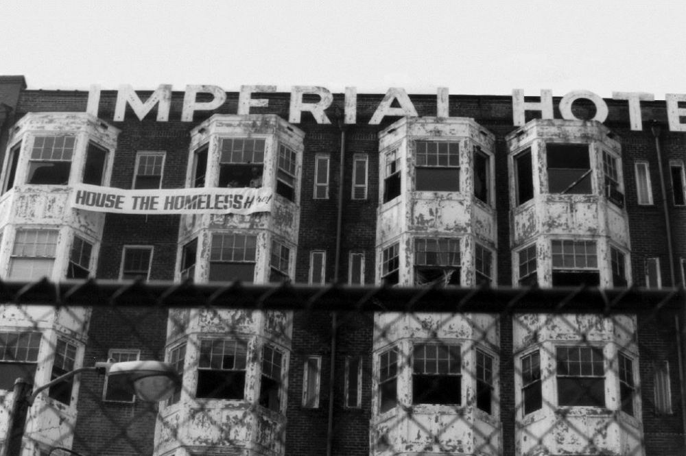 """On June 18, 1990 a group called People for Urban Justice broke into the abandoned Imperial Hotel to hang a sign that said """"House the Homeless Here!"""" The event turned into a 16-day occupation that raised awareness to the plight of Atlanta's homeless."""